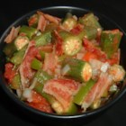 Okra Salad - This is a fried okra salad with bacon, onion, and tomato in a tangy vinegar dressing. Frozen okra makes it easy to enjoy year-round.