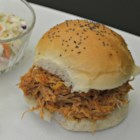 Awesome Pulled Pork BBQ - Tender pulled pork is smothered with a tangy apple cider barbecue sauce in this easy slow cooker recipe.