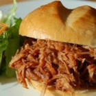 Faye's Pulled Barbecue Pork - Your guests will love the saucy little sandwiches you create from a pork roast that is seasoned with cayenne, garlic and onions, and then simmered until the meat is fork-tender. Stir in some barbecue sauce and you have a sensational party dish!