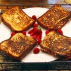 Stuffed French Toast II - Cream cheese and raspberry jam sandwiches are transformed into wonderful slices of stuffed French toast! Feel free to experiment with this recipe - it's very versatile.
