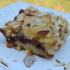 Berry Almond Bars - Delicious bar cookie that uses white or vanilla chips in the batter.  You can use any flavor of berry jam you'd like.