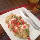 Traditional Chilaquiles - Freshly fried tortilla chips are layered with a spicy chicken and tomatillo sauce and plenty of cheese. Serve it with fried eggs for hearty breakfast or as a cheesy dinner.