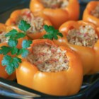 Stuffed Orange Peppers - Orange bell peppers are stuffed with ground turkey, rice, tomatoes, and Gouda cheese for a quick and easy weeknight dinner.