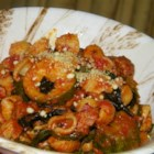 Debbie's Zucchini Skillet Dinner - Tender zucchini is simmered in a meaty tomato sauce with shell pasta in this family-pleasing dinner.