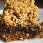 Gramma's Date Squares - A date filled bar with a chewy oatmeal crust. This is my grandmother's recipe which my whole family loves.  You can use almond extract instead of lemon, if you wish.