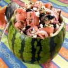 Watermelon Summer Salad - Watermelon is tossed with onion, feta cheese and olives in this intriguing summer dish. Don't be scared by the ingredients, they work together to make a very tasty and refreshing salad. Go ahead and try it - be prepared for a pleasant surprise!