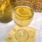 White Sangria - A wonderful punch made with white wine, mango and orange slices. Peach schnapps, cognac and ginger ale round out this summer party drink.