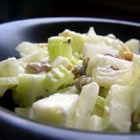 Waldorf Salad II - In this version of the classic Waldorf Salad, a mayonnaise based dressing with a hint of sugar and lemon juice is stirred into diced apples, celery, walnuts, and raisins.
