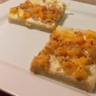 Mango Cream Cheese Pizza - Who says pizza needs to be savory? This fruity version doubles as an appetizer or dessert!