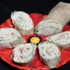 Turkey Roll Sushi - Turkey sushi rolls made with tortillas and a veggie cream cheese spread will make your non-seafood-loving friends very happy.