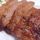 Western Style Flat Iron Steaks - Tender flat iron steaks are given a zesty rub with chili powder, cumin, cilantro, lime juice, and molasses in this recipe for western-style flat iron steaks.