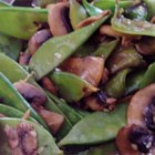 Stir Fried Snow Peas and Mushrooms - Snow peas and sliced mushrooms are tossed with sesame seeds and teriyaki sauce.