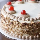Italian Cream Cake II - Creamy Italian frosting and a light and fluffy cake with pecans and coconut create this recipe for Italian cream cake.