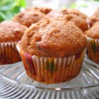 Whole Wheat Pumpkin-Applesauce Muffins - These muffins taste great right from the oven, but are even better the next day—if they last that long! Kids love them and it's a good way to sneak fruits, veggies, and fiber into their diets.