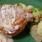 Pork Chops with Blue Cheese Gravy - This recipe makes the most delicious creamy blue cheese gravy to serve over pork chops. It tastes like something from a fancy restaurant. Serve with sauteed mushrooms, if desired
