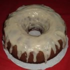Holiday Pumpkin Cake with Rum-Cream Cheese Glaze - Pumpkin puree is the key ingredient in this moist bundt cake topped with a luscious rum-cream cheese glaze. It will give any pumpkin pie a run for its money!