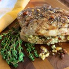 Pesto Stuffed Pork Chops - Bone-in pork chops are stuffed with feta cheese, basil, and pine nuts and baked with a balsamic vinegar glaze in an easy and quick family favorite main dish.