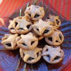Mini Orange Mince Pies - Orange zest added to the buttery crust of little, individual mincemeat pies adds sparkling flavor.