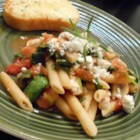Suki's Spinach and Feta Pasta - Penne pasta mingles with onion, garlic, tomatoes, mushrooms, wilted spinach and feta with a dash of red pepper flakes for zip.