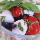 'Cherry' Caprese Salad - This version of caprese salad is just small balls of mozzarella, cherry tomatoes, fresh basil, and black olives tossed together.