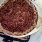 Pecan Pie - A corn syrup, egg and sugar filling is poured over whole pecans in an unbaked crust in this seasonal dessert.