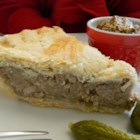 Terri's Tourtiers (French-Canadian Santa Pies) - Tourtiers--French-Canadian pork pies--are a traditional dish made during the holiday season. Serve each slice with cornichons and grainy Dijon mustard.