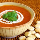 Creamy Tomato Soup (No Cream) - This creamy tomato soup recipe is made creamy without cream, thanks to bread cubes and butter pureed into the soup.