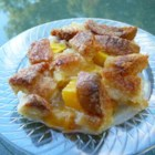 Too Easy Peach Cobbler - Fresh peaches are sliced and arranged in an 8x8-inch pan and covered with strips of white bread instead of the traditional biscuit dough.