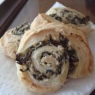 Artichoke and Spinach Swirls - Flaky puff pastry holds a creamy artichoke and spinach filling.