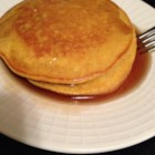 Simply Pumpkin Pancakes - Quick, easy, and delicious, these light and flavorful pumpkin pancakes are best when served warm with butter and syrup.