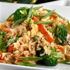 Stir-Fried Rice - Fried rice in 15 minutes! Cook Minute(R) Rice with chicken broth, stir-fry  vegetables, soy sauce and egg. You'll feel good about serving your family this low- calorie, low-fat dish.