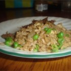 Egg Fried Rice - Did you know that egg is the key to great fried rice? This is a quick easy recipe of instant rice fried with egg, onion, green beans and soy sauce.