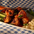 Buffalo Chicken Meatballs - Buffalo chicken meatballs made with ground chicken and hot sauce are perfect for Sunday football. Serve with ranch or blue cheese dressing.