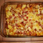 Alisha's Scalloped Potatoes and Ham - Cooked potatoes are partially mashed to make a creamy casserole with chunks of ham dotted throughout.