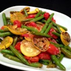 Squash and Green Bean Saute Side Dish - Squash and green beans are pan-fried in a lemon-based sauce creating a quick and easy side dish.