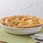 Crisco(R) Chicken Pot Pie - This hearty comfort food is filled with so much goodness - chopped veggies, rotisserie chicken, grated Cheddar cheese and a crispy crust that melts right into the filling.