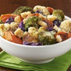 Herb Roasted Vegetables with Garlic Croutons - Cauliflower, broccoli, carrots, and red cabbage are roasted with herbs and topped with crushed garlic croutons for a colorful veggie side dish.