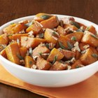 Molasses Glazed Sweet Potatoes with Sage & Pecans - Roasted sweet potato cubes are quickly sauteed with molasses, cinnamon and cayenne pepper and served with browned sage and chopped pecans.