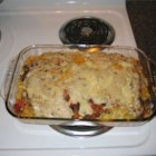 Baked Fettuccine Lasagna - Creamy and comforting, this noodle casserole combines sauteed onion and bell peppers with ground beef, tomatoes, mushrooms and olives. Layer with cooked fettuccine, Cheddar cheese and mozzarella cheese, and pour mushroom soup over the top.