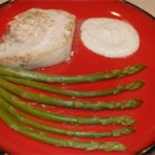 Lemon Thyme Swordfish with Asparagus - Baked swordfish with a lemon and thyme cheese sauce. Garnish with lemon slices and sprigs of thyme.