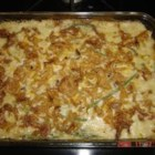 Cheesy Green Bean Casserole - Two kinds of grated cheese are incorporated into this  variation on a classic green been casserole.