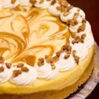 Marbled Pumpkin Cheesecake - This is a wonderful pumpkin cheesecake with a gingersnap crust. The gingersnap really does make a difference.