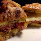 The Ultimate Apple Cinnamon Grilled Cheese Sandwich - A special grilled cheese breakfast sandwich, made with cinnamon buns, Cheddar and Brie cheeses, apples, and sliced ham, is dipped in egg and pan-fried until golden brown.