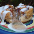 Stuffed Cinnamon Rolls - Cinnamon rolls stuffed with apple pie filling are a quick and easy breakfast treat thanks to refrigerated cinnamon roll dough. Top warm rolls with icing!