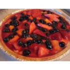 Fruity Tart - Vanilla pudding never had it so good. It 's cooked up, poured into a pre-baked crust, topped with slices of fresh fruit, and brushed with a yummy apricot jam glaze.