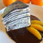 Chocolate Crepe Cake with Salted Chocolate Orange Sauce - A delicious cake that combines flavors that everyone loves--chocolate and orange.