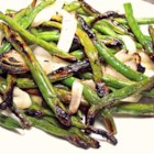 Grilled Green Beans and Onions - Fresh green beans and onions take on a whole new flavor profile when grilled with a little Diamond Crystal(R) Kosher Salt. The green beans become smoky and the onions become sweet. The perfect side dish to any meat or fish main dish.