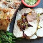 Herb Salted Pork Loin with Dried Fruit & Pistachio Stuffing - Pork loin roast is stuffed with pistachios, cranberries, and raisins then rubbed with a garlic-herb-salt mixture and roasted for a fabulous holiday main dish.
