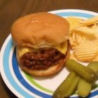 Dallas-Style Sloppy Joes - A zesty sauce, fresh onion, and bell pepper make this easy-to-make sandwich a Dallas-area favorite.