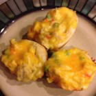 Chicken Biscuits - Prepared biscuit dough is made into small crusts containing chicken and vegetables in a creamy sauce and topped with Cheddar cheese for a fun take-along small meal or snack.
